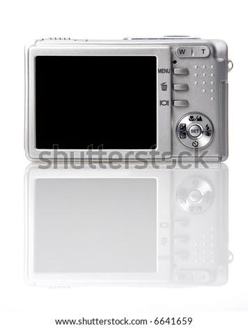 Digital camera on white background with reflection - stock photo