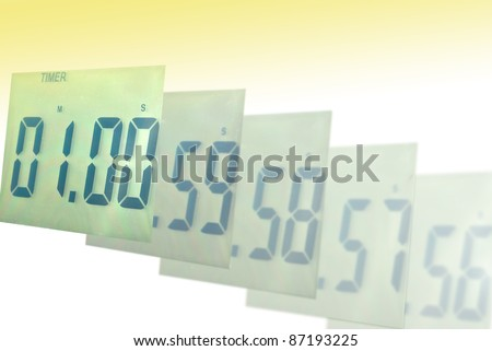 Digital clock blur to one minute - stock photo