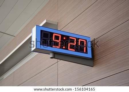 Digital Clock on a wall - stock photo