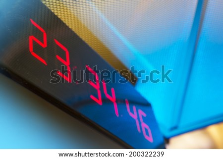 Digital clock on the wall - stock photo