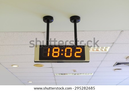 Digital clock on the wall in airport. - stock photo