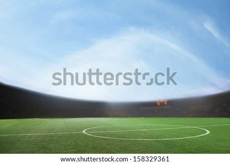 Digital composit of soccer field and blue sky - stock photo