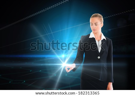 Digital composite of blonde businesswoman touching light