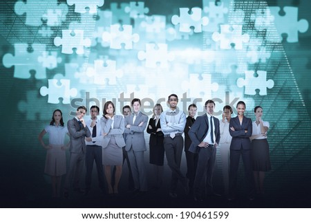 Digital composite of business team against jigsaw background