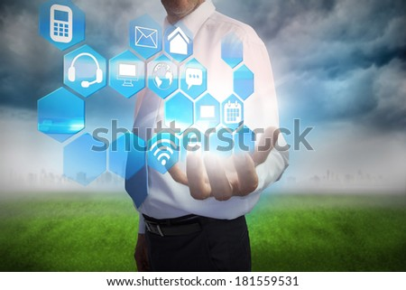 Digital composite of businessman presenting interface menu with apps