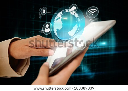 Digital composite of businesswoman touching tablet with interface and earth