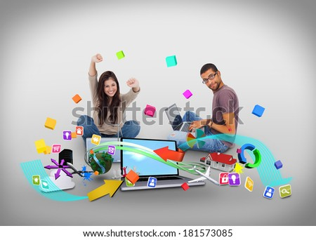 Digital composite of cheering girl and casual man using laptop with app icons - stock photo