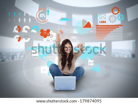 Digital composite of cheering girl using laptop with interface - stock photo