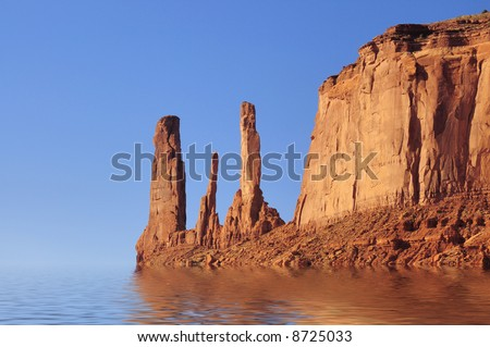 Digital composite of exotic rock spires jutting out of endless blue sea (based on Three Sisters mesa in Monument Valley, Navajo Nation) - stock photo