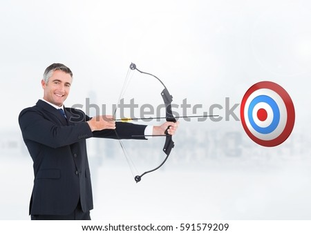 Digital composition of businessman aiming at the target board against white background