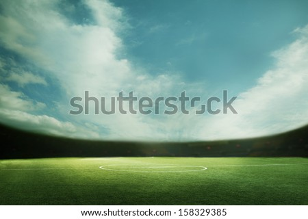 Digital composition of soccer field and blue sky - stock photo