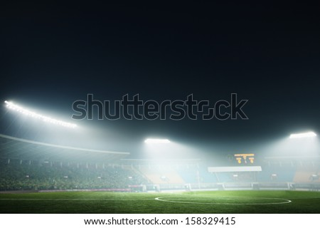 Digital coposit of soccer field and night sky - stock photo