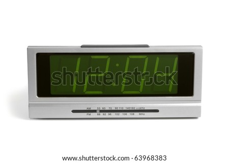 Digital electronic clock from radio on a white background - stock photo