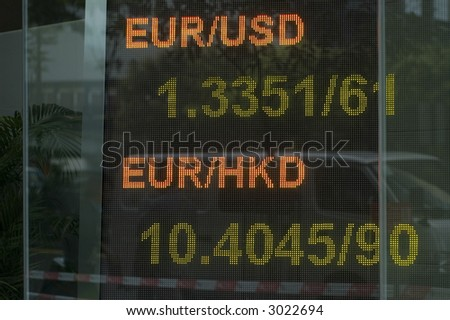 Digital exchange rate board in bank - stock photo