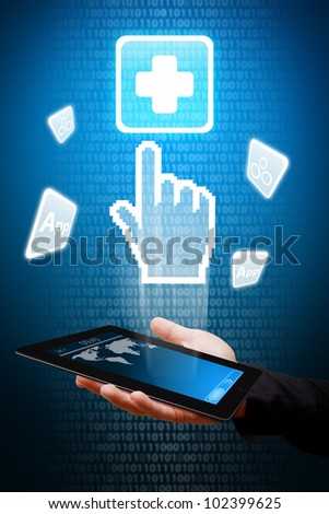 Digital hand point to First Aid icon from tablet computer - stock photo