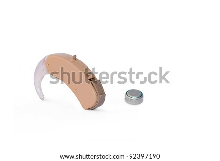 Digital hearing aid with its battery isolated on white. Clipping path included. - stock photo