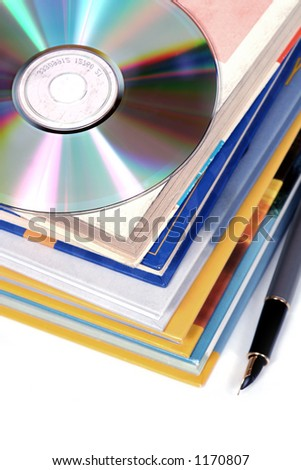 digital information - one disk replaces a pile of books - stock photo