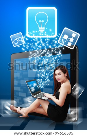 Digital lady present Light Bulb icon from tablet pc - stock photo