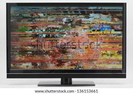 Digital LCD TV with Distorted Picture on Screen - stock photo
