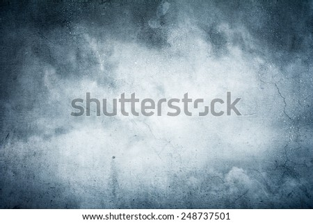 digital manipulation made out of 2 pfotos, concrete wall and stormy sky to achieve artistic effect - stock photo