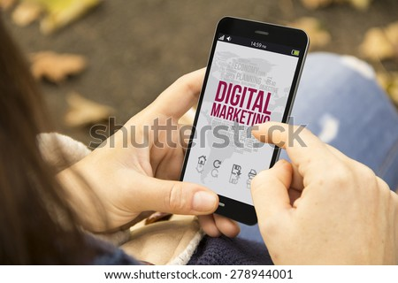 digital marketing concept: young woman with digital marketing 3d generated smartphone at the park - stock photo