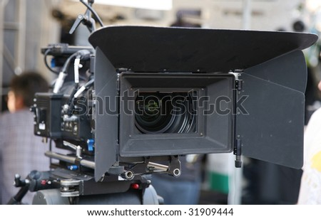digital motion picture camera with matte box on location - stock photo