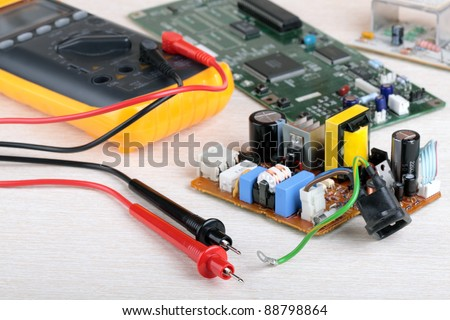 Digital multimeter and electronic parts of the radio equipment - stock photo