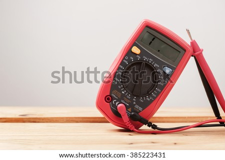 digital multimeter or multitester or Volt-Ohm meter, an electronic measuring instrument that combines several measurement functions in one unit.