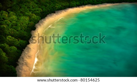 digital painting of a tropical coastline from an aerial view - stock photo