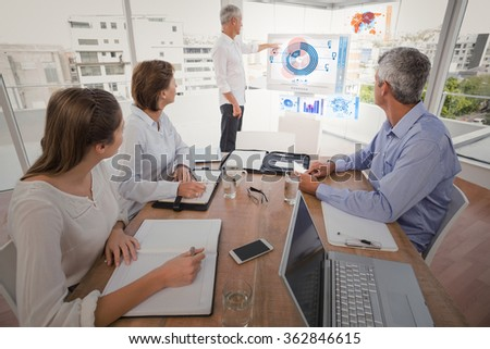 Digital pie chart against business people listening to colleagues presentation - stock photo