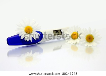 Digital Pregnancy Test with flowers - stock photo