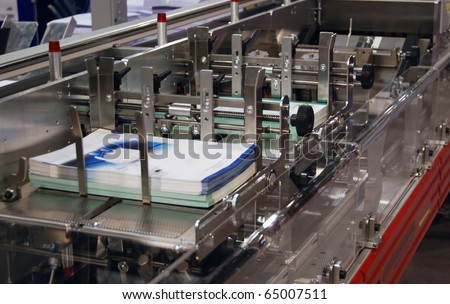 Digital press printing in printshop. Digital press printing is the reproduction of digital images on a physical surface. - stock photo