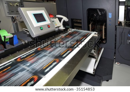 Digital press printing is the reproduction of digital images on a physical surface. It is generally used for short print runs, and for the customization of print media. - stock photo