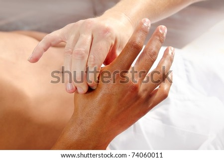 digital pressure hands reflexology massage tuina therapy physiotherapy - stock photo