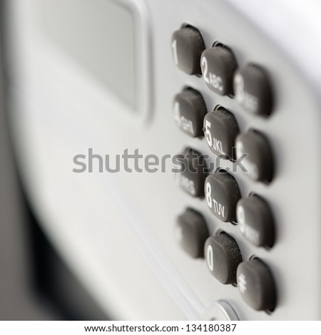 Digital safety deposit lock box safe with with digital lock, screen panel, numeral buttons. Shallow depth of field.