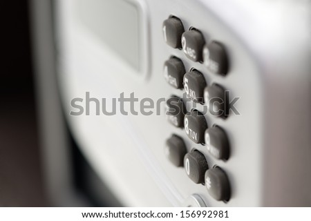 Digital safety deposit lock box safe with with digital lock, screen panel, numeral buttons. Shallow depth of field. - stock photo