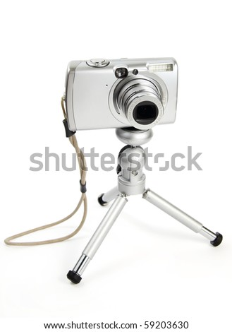 Digital small camera on tripod on white background with clipping path - stock photo