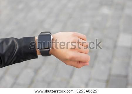 Digital smartwatch on wrist  - stock photo