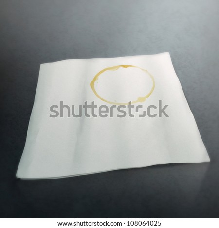 digital still-life painting of a napkin with a ring-shaped coffee stain - stock photo