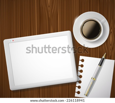 digital tablet and a cup of coffee on the table - stock photo