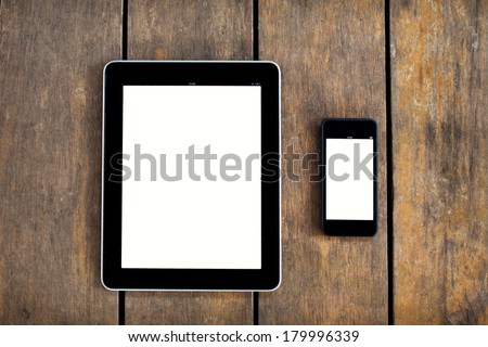 digital tablet and smartphone on the table - stock photo