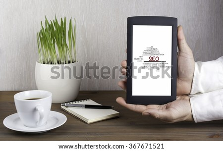 Digital tablet computer with isolated screen in male hands, SEO concept - stock photo