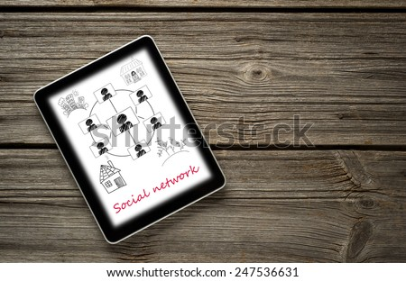 Digital tablet computer with  social networks concept isolated screen on old wooden background - stock photo