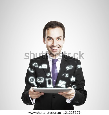 digital tablet in hand and icon - stock photo