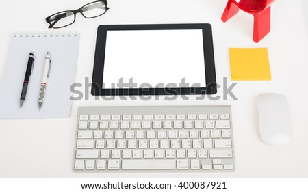 Digital tablet touch pad computer with keyboard, mouse and clock in office table business