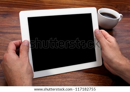 Digital tablet with blank screen in coffee shop - stock photo