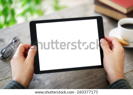 Digital tablet with blank screen in coffee shop cafe - stock photo