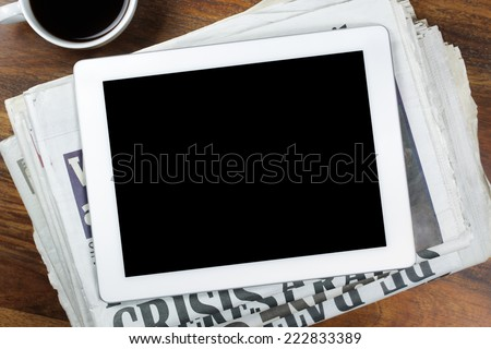 Digital tablet with blank screen on newspaper concept for internet and electronic news - stock photo