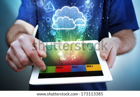 Digital tablet with multimedia, e-mail, e-commerce and social media icons flying out of the screen concept for cloud computing, mobility and internet - stock photo