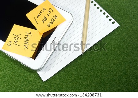 digital Tablet with note pad and line papers - stock photo